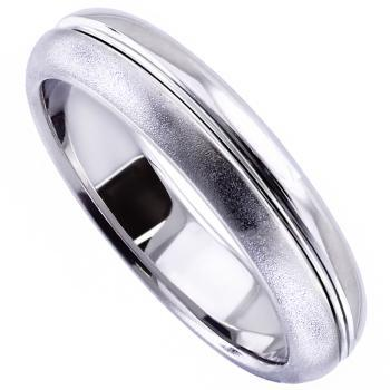 half rounded wedding ring with a deeper engraved line in the middle
