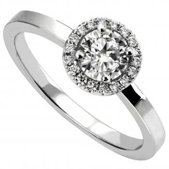 halo ring with a central brilliant cut diamond surrounded by smaller diamonds on a slim band