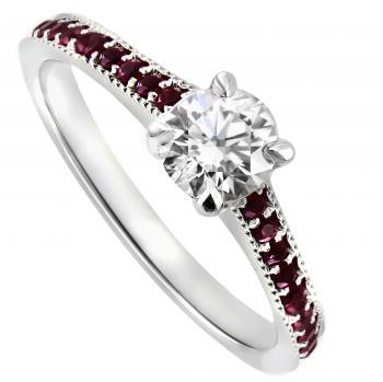 solitaire ring with a central brilliant cut diamond with a milligraine finished band set with rubies