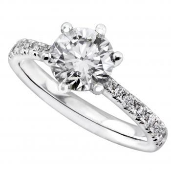 solitairering with brilliant cut diamond set in a with curved 6 prong basket and on the side descending smaller diamonds