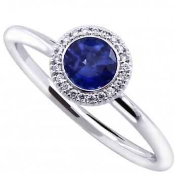 halo ring with a round Ceylon heated sapphire american set and mounted on a round thin band with two rods and set with smaller brilliant cut diamonds