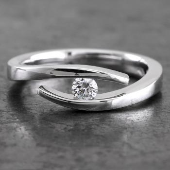 solitaire ring with a single brilliant cut diamond slim set in between the softened band