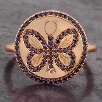 ring with an engraved and pavé set butterfly with black brilliant cut diamonds on a disc