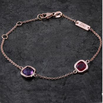 rolo bracelet with two birthstones, a cushion or antique cut ruby and an amethyst set in donuts combined with a plate with personal engraving of first names (extra rings on one and two cm)