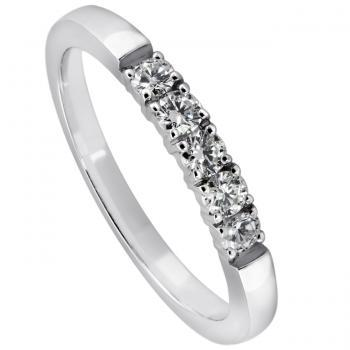 wedding ring set with brilliant cut diamonds set with four prongs per diamond