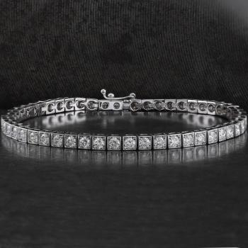 bracelets with brilliant cut diamonds set in small blocs with four grains for each diamond