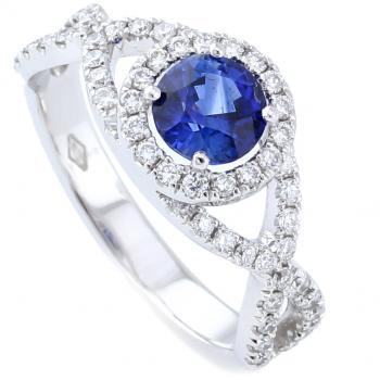 halo ring braided pavé band with a central sapphire and smaller brilliant cut diamonds on the side