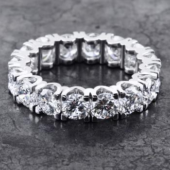 full eternity ring with round brilliant cut diamonds set in four V-shaped prongs